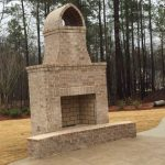 FireRock outdoor fireplace with Seaside white brick and ivory mortar