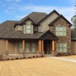 Castle Rock Tudor brown brick with Buff, Southern Ledgestone Chardonnay